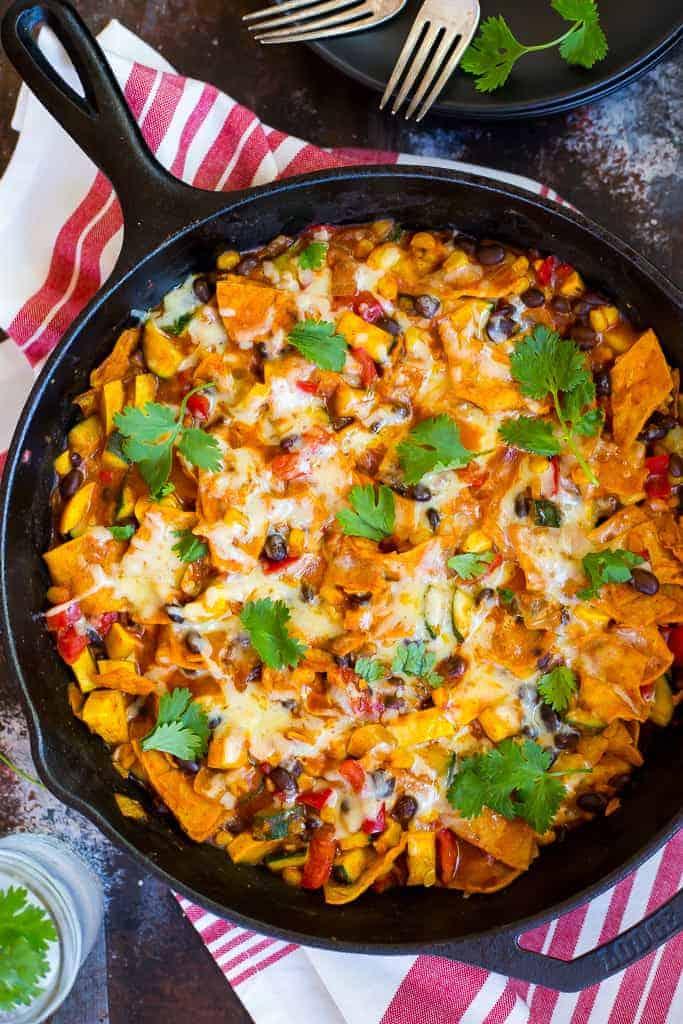 one pot stovetop enchiladas in black cast iron skillet with fresh cilantro