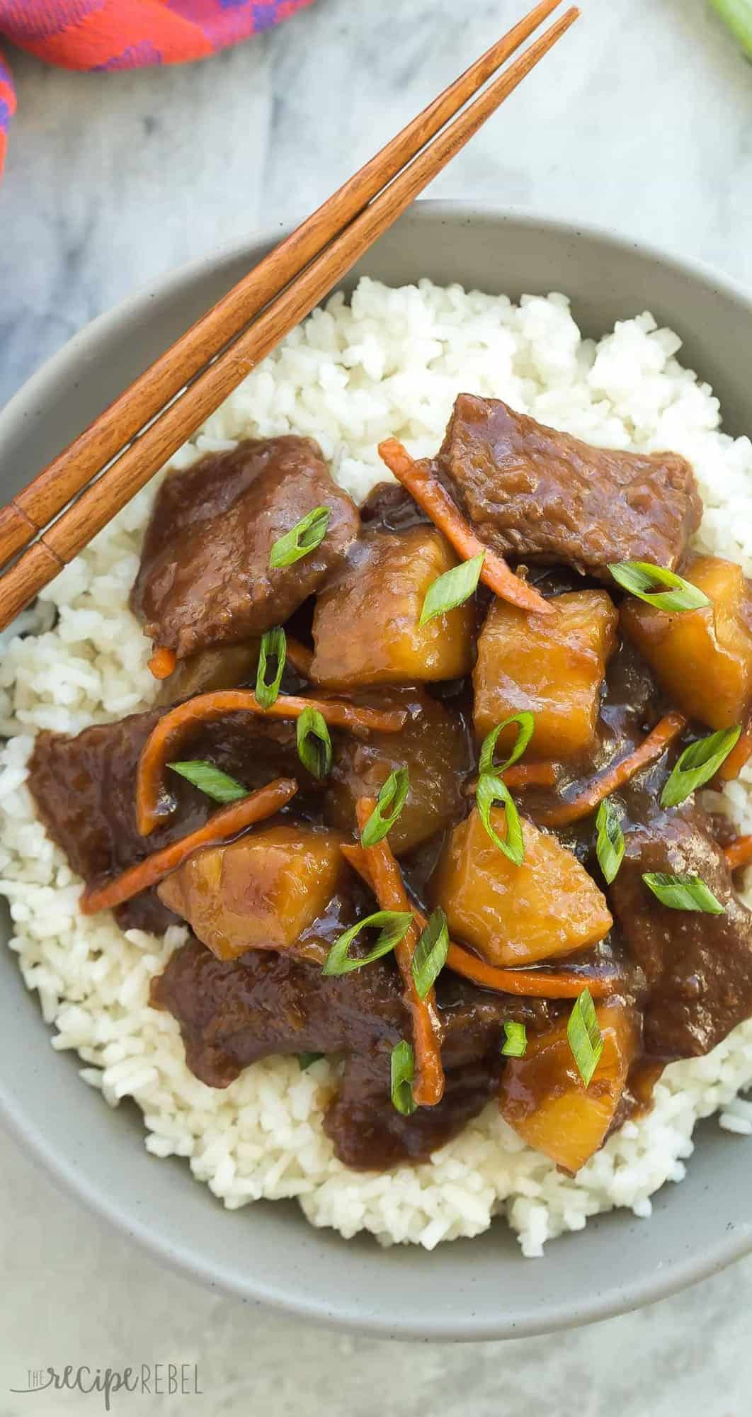 This Slow Cooker Mongolian Beef is sweet, sticky and a little spicy and loaded with pineapple! It's your new favorite Asian takeout dish made at home in the crockpot!