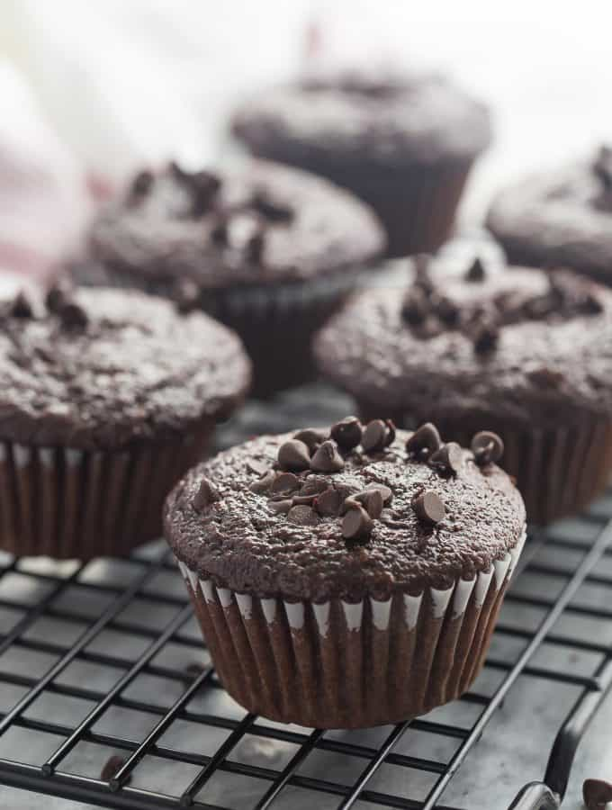 These Double Chocolate Muffins are so moist (thanks to buttermilk, canola oil and applesauce) and loaded with chocolate flavor! Make them with whole wheat flour for extra fiber! The perfect lunch box snack.