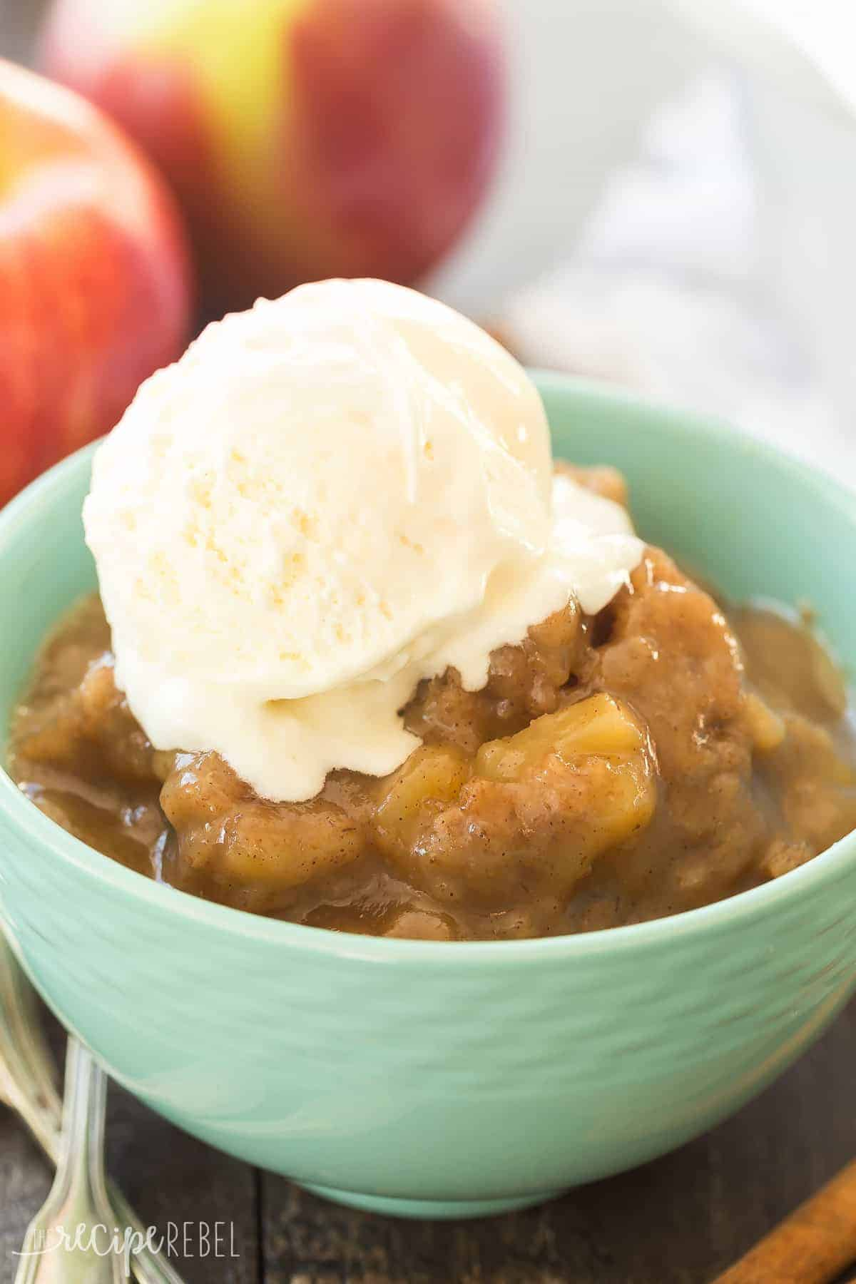 close up image of slow cooker caramel apple pudding cake with vanilla ice cream