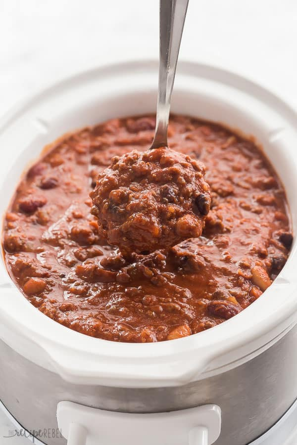 slow cooker chili in white crockpot with metal scoop
