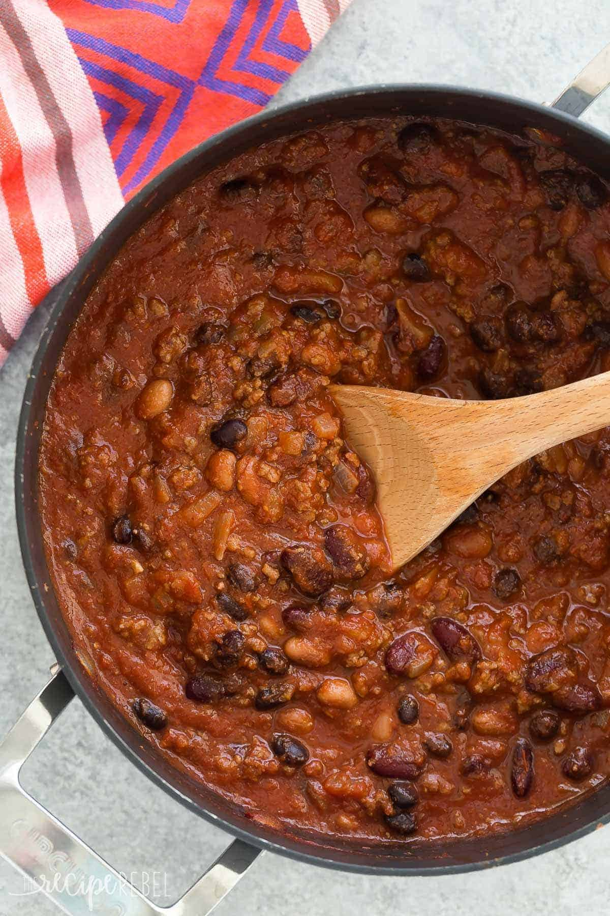 This Slow Cooker Three Bean Beef Chili is a hearty, but so easy protein loaded meal for any night of the week! A microwave shortcut makes makes it a one pot meal and cuts down on prep time. Includes how to recipe video. | crockpot recipe | crock pot | chili recipe | beef recipe |