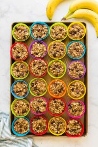 banana chocolate chip baked oatmeal cups in silicone muffin cups