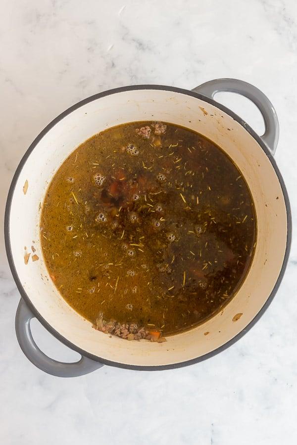 broth added to dutch oven to make macaroni soup