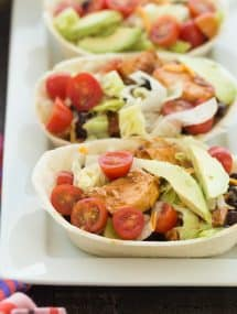 These BBQ Chicken Taco Bowls are an easy make ahead meal -- freezer friendly and perfect for your week's meal prep! The chicken can be made on the stovetop, in the slow cooker or Instant Pot. Includes step by step recipe video. | meal prep | make ahead | freezer | low calorie | healthy meal | dinner recipe | easy recipe | chicken recipe