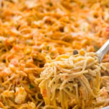 chicken spaghetti being scooped out of pan
