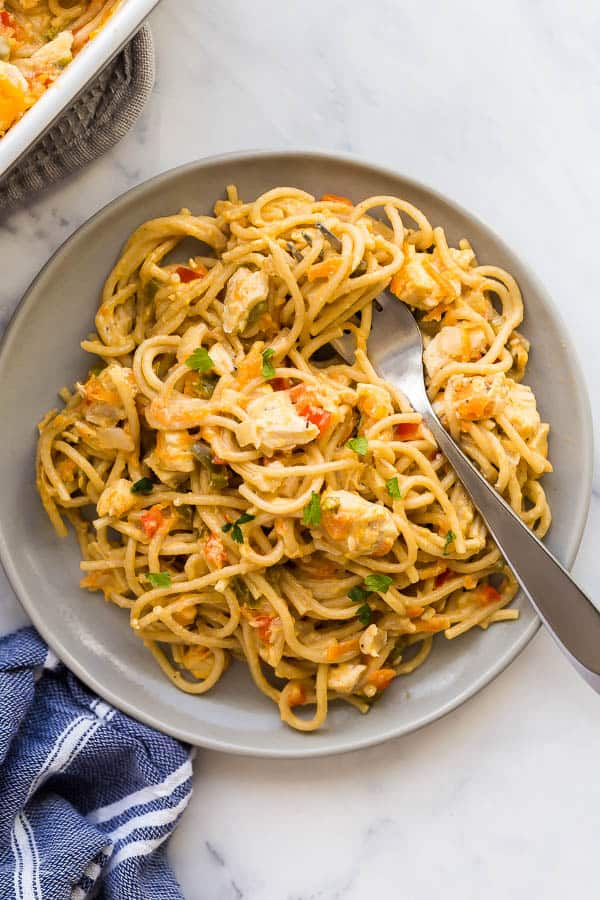 plate of chicken spaghetti with fork stuck in noodles