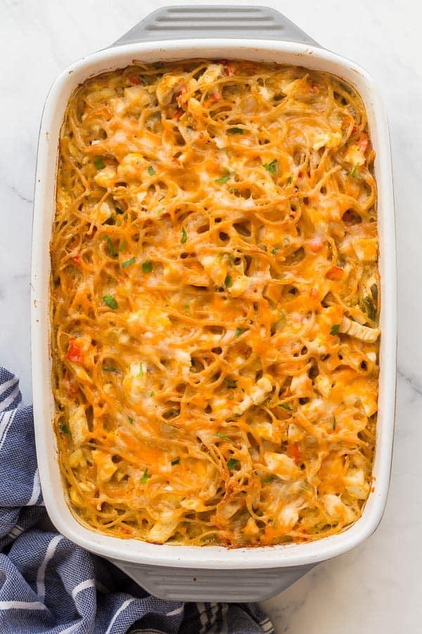 overhead image of chicken spaghetti bake in white dish