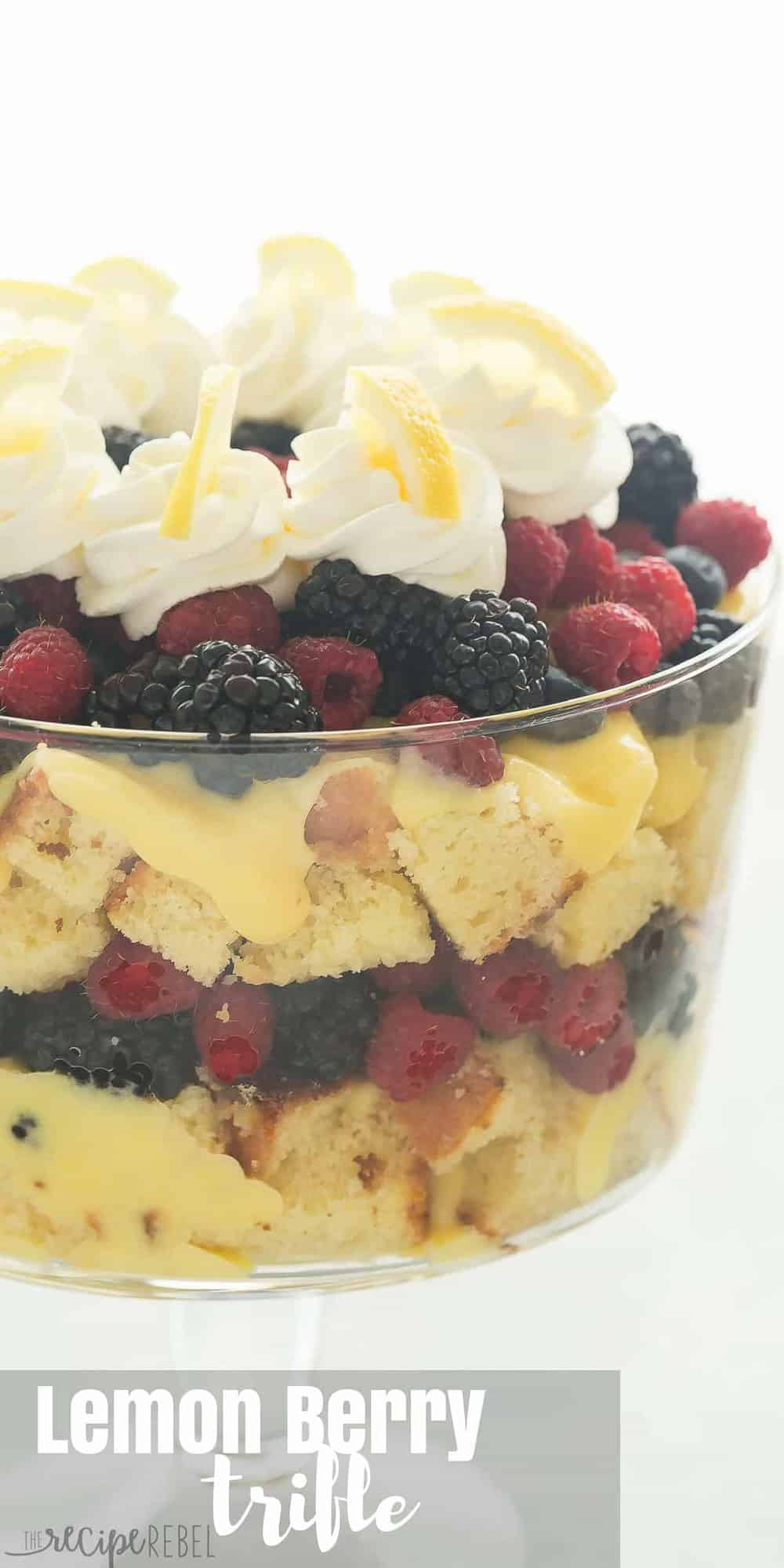 This Lemon Berry Trifle is made up of a homemade Greek Yogurt Lemon Cake, vanilla pudding, whipped cream and piles of fresh berries! It is the perfect summer dessert! Includes step by step recipe video | lemon dessert | spring dessert | easy recipe | Easter | Christmas dessert | baking
