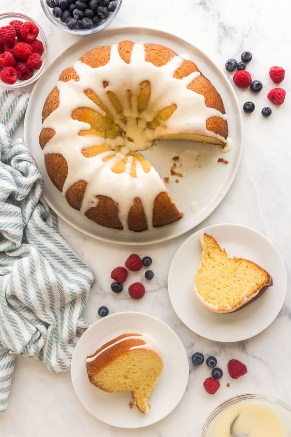 overhead image of lemon bundt cake with two slices on plates