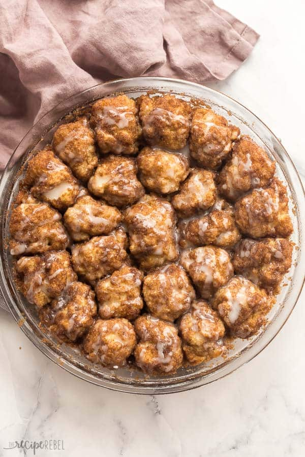 overhead image of cinnamon roll bites in pan on white background