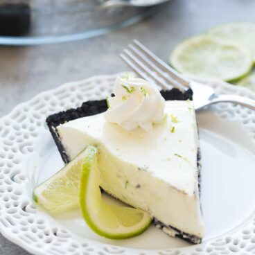 This (Almost) No Bake Key Lime Pie is made extra special with a chocolate cookie crust! It's a smooth, creamy, no fuss dessert perfect for summer or winter. Includes step by step recipe video. | no bake pie | no bake dessert | citrus | easy recipe | easy dessert