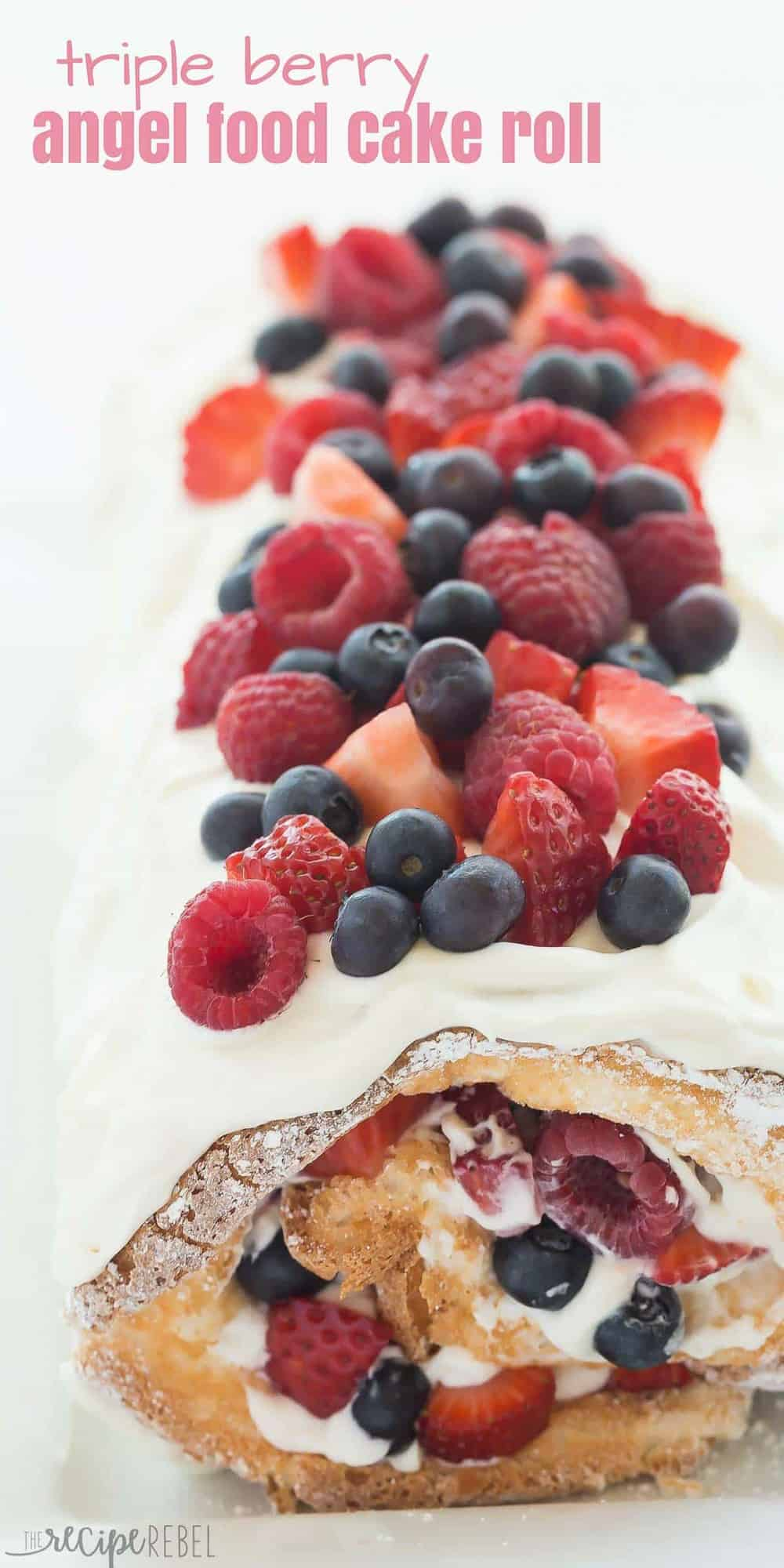 This Triple Berry Angel Food Cake Roll is an easy red, white and blue dessert (or just red and white!) for the 4th of July or Canada Day, or any day! Perfect with fresh summer strawberries, raspberries and blueberries :) Includes step by step recipe video. | 4th of july | july 4 | Canada Day | summer dessert | fresh fruit | easy dessert | cake mix