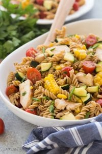 This BBQ Chicken Pasta Salad is loaded with fresh summer vegetables and chicken and tossed in a light dressing with a hint of barbecue flavor for an easy, meal in one perfect for picnics! Step by step recipe video. | summer salad | picnic salad | cold salad | summer veggies | healthy recipe