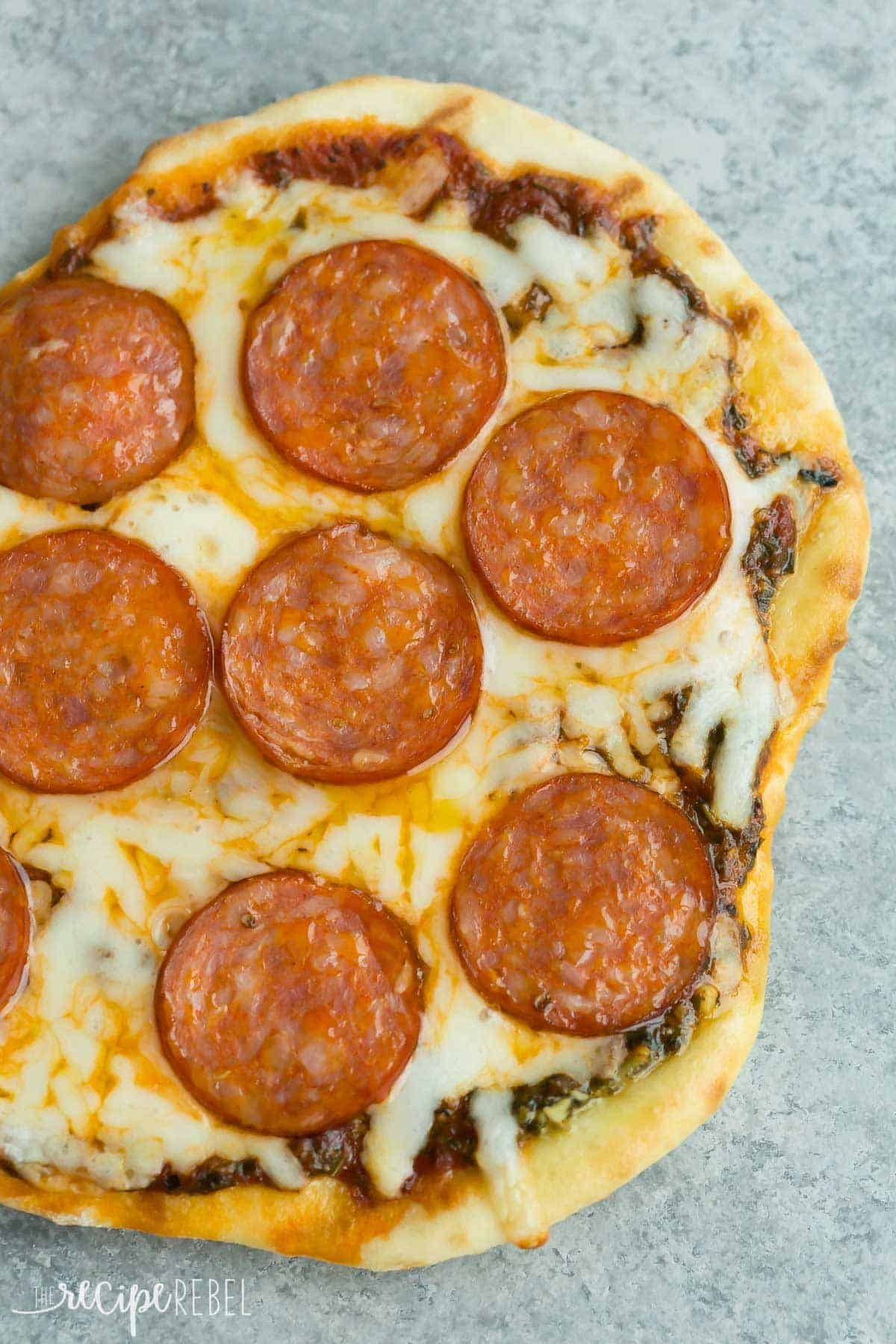 Grilled pizza is an easy summer meal! 4 flavour variations including Pesto Pepperoni, BBQ Hawaiian, Tomato Basil and Banana S'mores -- the ultimate summer dessert pizza! | grilling | summer recipe | barbecue | summer entertaining |