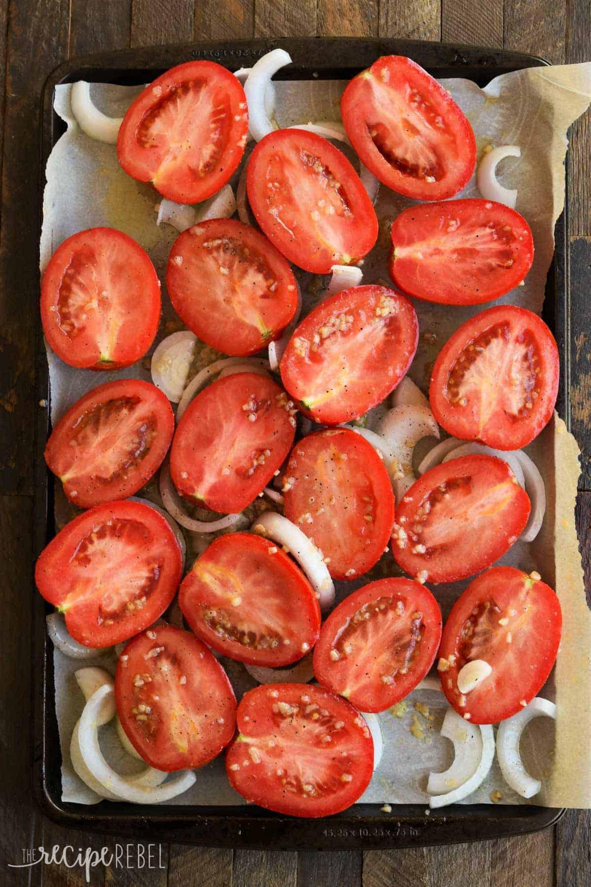 fresh tomatoes and onions on sheet pan overhead