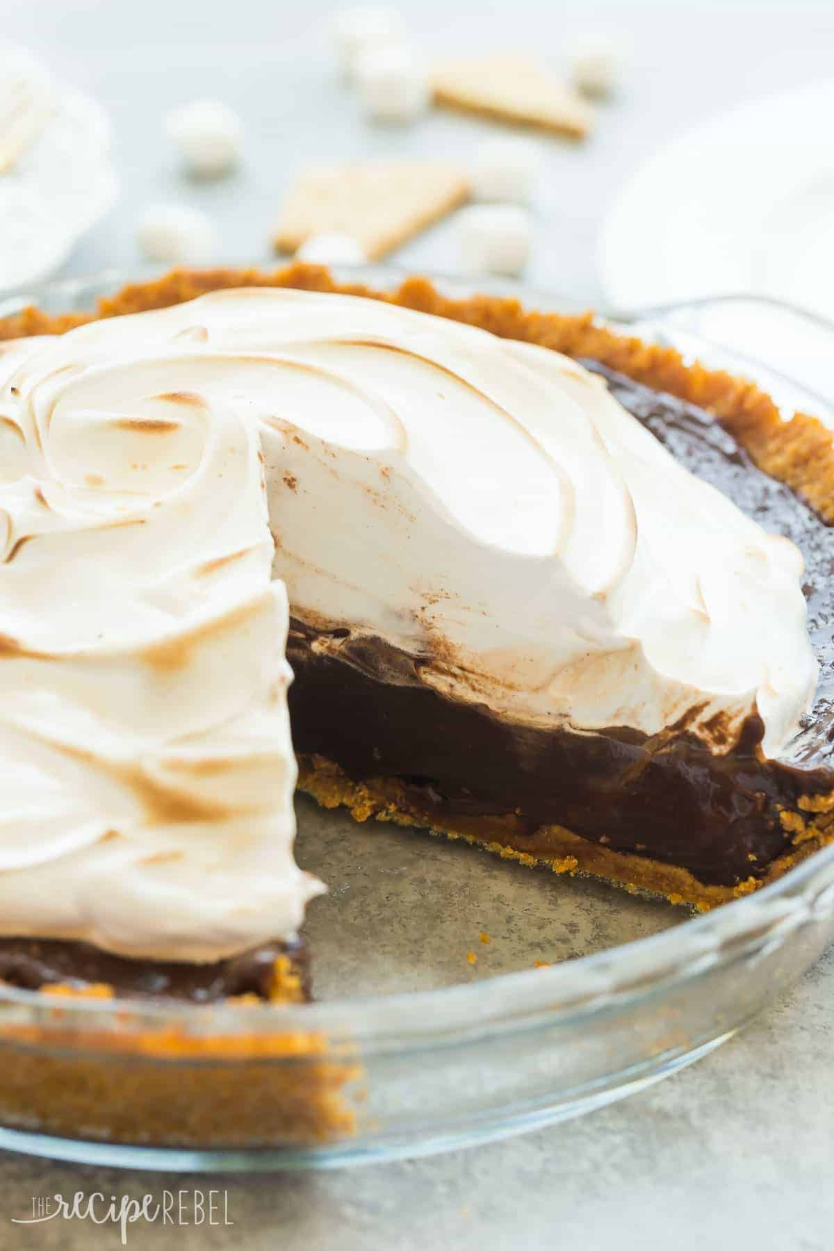 smores pie in glass pie plate whole with piece missing