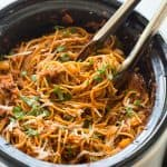 This Healthier Slow Cooker Spaghetti and Meat Sauce is loaded with veggies and protein but tastes just like your old favorite! It cooks completely in the slow cooker -- even the pasta! Includes step by step recipe video. | slow cooker recipe | crock pot recipe | crock pot dinner | ground beef recipe | healthy dinner | low calorie | high fiber