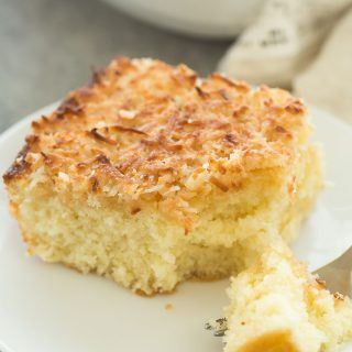 This Hot Milk Cake with Broiled Coconut Frosting -- also known as a Lazy Daisy Cake -- is a super moist vanilla cake covered in a crunchy, toasted coconut topping. It's one of my favorite cakes of all time! Includes a step by step recipe video. | easter | spring | Easter dessert | coconut dessert | baking | cooking | easy recipe