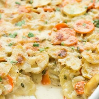These Garlic Parmesan Scalloped Potatoes and Carrots are the ultimate comfort food and perfect for using up summer vegetables! An easy side dish perfect for Thanksgiving or any holiday. Includes step by step recipe video. | Easter | Thanksgiving | Christmas | cheesy potatoes | easy potato recipe | holidays