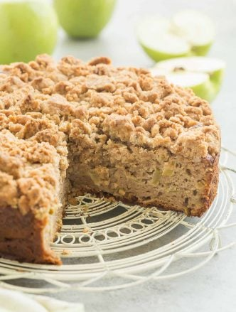 This Apple Coffee Cake with Crumb Topping is the perfect fall breakfast or dessert -- Greek yogurt makes it so moist and it's loaded with apples and the best crunchy brown sugar streusel! | apple cake | baking | fall baking | fall recipe | breakfast | brunch | Greek yogurt cake | apples | Thanksgiving | Christmas