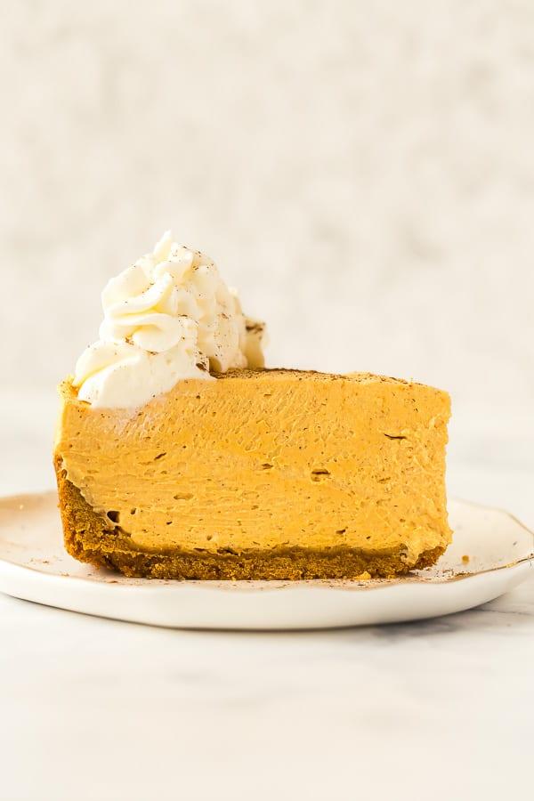 no bake pumpkin cheesecake slice on white plate