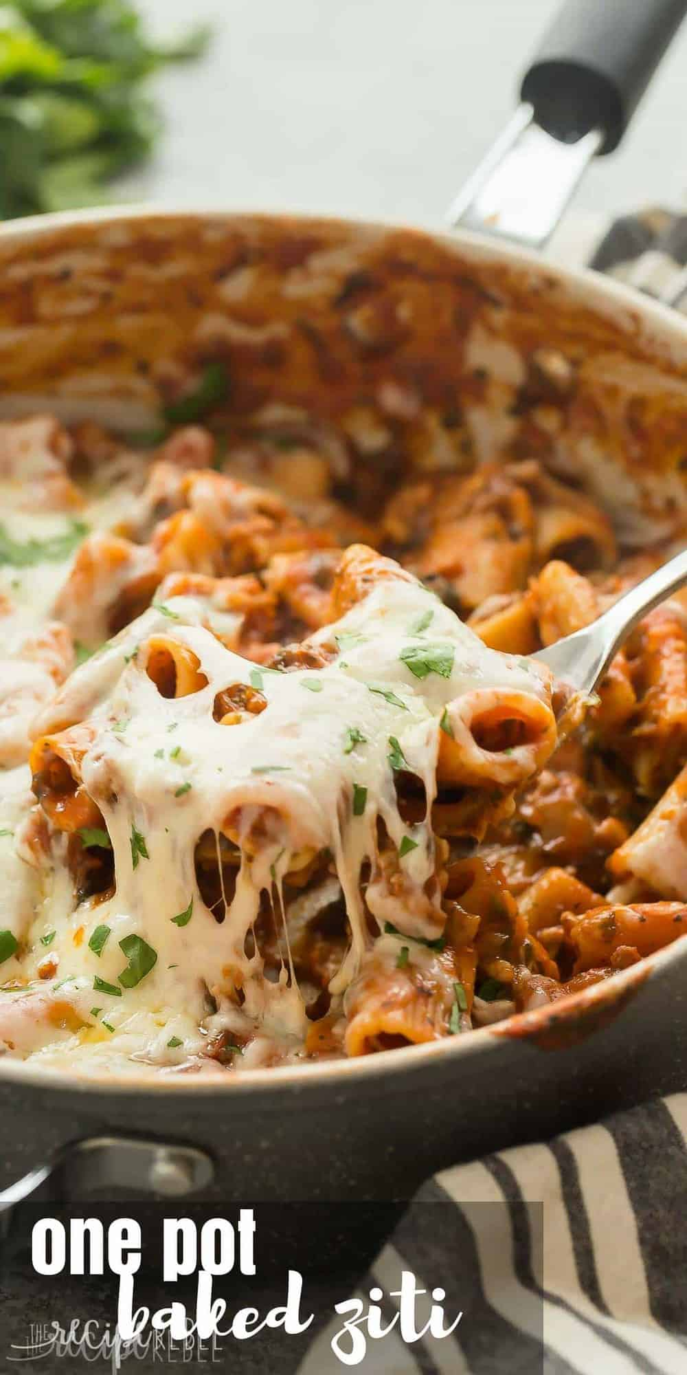 long image of one pot baked ziti being pulled out of skillet with spoon
