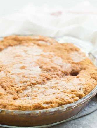 This Easy Pumpkin Pudding Cake takes just 10 minutes prep and makes it's own caramel pudding sauce as it bakes! Perfect hot from the oven with a scoop of ice cream. | pumpkin dessert | easy dessert | baking | Thanksgiving dessert | lava cake | caramel sauce