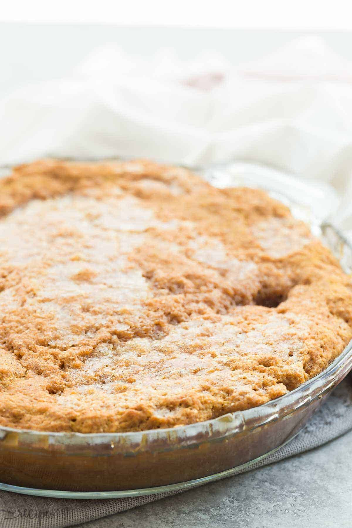 pumpkin pudding cake in glass pie plate whole