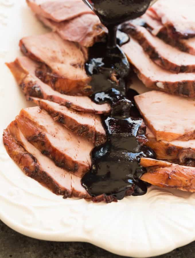 This Slow Cooker Balsamic Cherry Glazed Ham couldn't be easier -- the slow cooker keeps the meat so juicy and the Balsamic Cherry Glaze adds so much sweet and tangy flavor! It's perfect for Easter, Christmas or Thanksgiving. Includes step by step recipe video. | slow cooker recipe | crockpot | crock pot | holiday | sauce | cherry sauce | glaze for ham