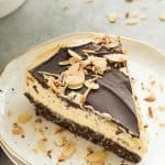 This No Bake Nanaimo Bar Cheesecake has all of the familiar flavors of the classic Nanaimo bar but in an easy no bake cheesecake! The perfect Christmas dessert (but I won't tell if you indulge year round!). Includes step by step recipe video.   no bake cheesecake   no bake dessert   chocolate   almonds   coconut