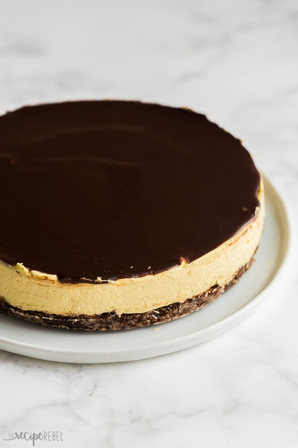no bake nanaimo bar cheesecake whole with chocolate ganache