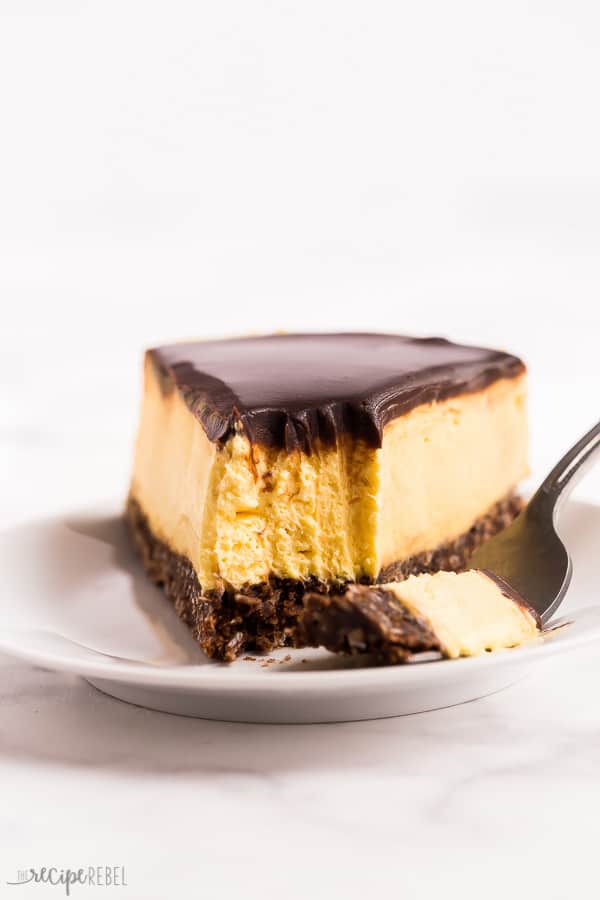 no bake nanaimo bar cheesecake bite close up on white plate with white background