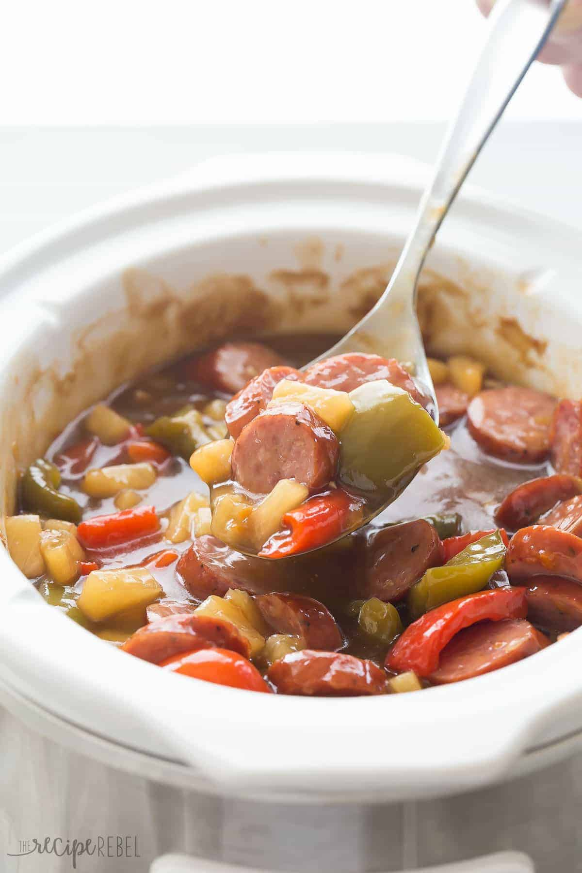 These Sweet & Sour Slow Cooker Smokies are an easy holiday appetizer or weeknight meal! Just a few minutes prep and let them cook away in the crockpot. Includes step by step recipe video. | slow cooker appetizer | slow cooker recipe | crock pot appetizer | holiday dish | game day | superbowl | potluck recipe | easy recipe