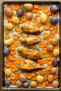 This Apricot Chicken Sheet Pan Dinner is an easy, healthy dinner recipe that requires just a few minutes prep and one pan! Loaded with potatoes and vegetables and topped with a simple apricot glaze. Includes step by step recipe video. | one pan dinner | one pan meal | glazed chicken | chicken and vegetables | healthy dinner idea | meal prep | low calorie