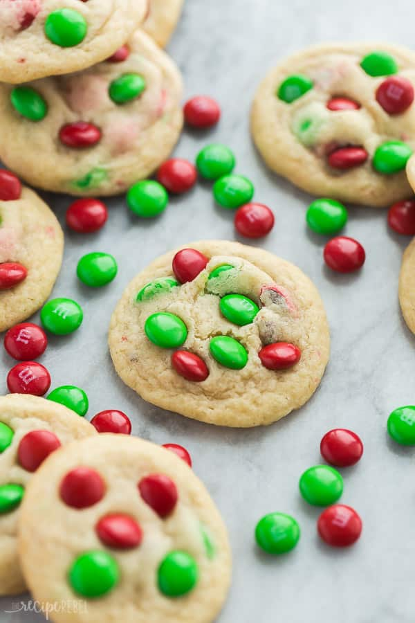 christmas cookies with m&ms close up of one cookie with lots of red and green m&ms around it