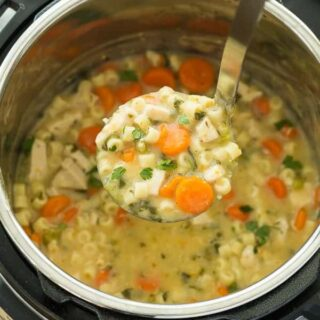 This Creamy Instant Pot Chicken Noodle Soup Recipe is a healthy dinner recipe that's easy enough for any day of the week! It's made in the pressure cooker which means BIG flavour and quick cooking. Loaded with vegetables and easily made dairy free or vegetarian. Includes step by step recipe video. | instant pot recipe | pressure cooker | healthy recipe | vegetables | spinach | pasta | one pot #onepot #instantpot #instantpotrecipe #pressurecooker
