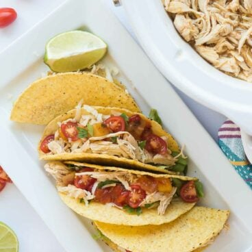 These Sweet & Spicy Slow Cooker Chicken Tacos are an easy, healthy, weeknight dinner! Just dump everything in the crockpot and forget about it. Step by step recipe video. | slow cooker recipes | crockpot recipe | crock pot recipe | chicken dinner | healthy recipe | low fat | low calorie | protein | game day | superbowl | #gameday #chickenrecipes #slowcookerrecipes