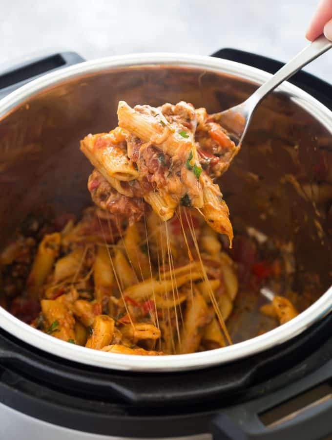 This easy Instant Pot Baked Ziti is a new twist on a classic favorite dish, made healthier with high fibre pasta, sneaky veggies, and extra lean ground beef. It's made completely in the Instant Pot or pressure cooker, so no extra dishes! You can even use frozen ground beef! Includes step by step recipe video. #instantpot #instantpotrecipe #pressurecooker pressure cooker recipe easy dinner #dinner #recipe #cooking #groundbeef easy ground beef recipe #onepot one pot