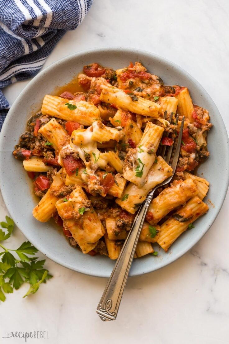 overhead image of baked ziti on plate with fork stuck in