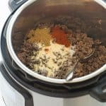This Instant Pot Taco Meat from Frozen Ground Beef is the easiest way to do weeknight dinner! No thawing the meat, no extra pots -- just throw it in the Instant Pot or pressure cooker, cook and season! This taco filling is perfect for tacos, burritos, quesadillas, or taco salad and great for prepping ahead! #instantpot #pressurecooker #instantpotrecipe #recipe #groundbeef #tacos pressure cooker recipe