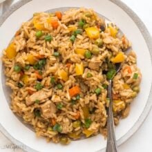 square image of instant pot teriyaki chicken and rice on white plate