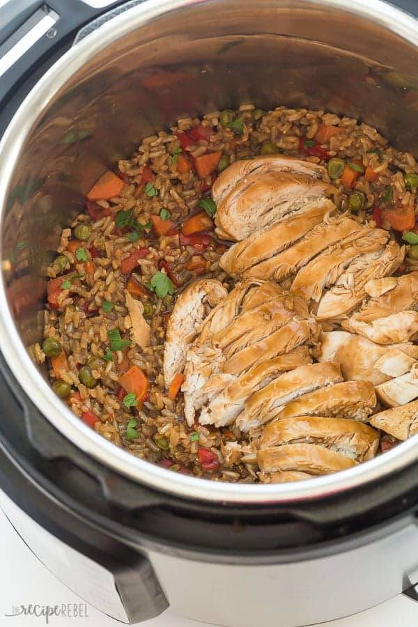 This Instant Pot Teriyaki Chicken and Rice is an easy dinner recipe made completely in one pot! Loaded with vegetables and covered in a sweet, tangy teriyaki sauce that cooks all together. A healthy dinner that comes together in minutes with no extra pots! #instantpot #pressurecooker #teriyaki #chicken #chickenrecipe #recipes #dinner #cooking pressure cooker