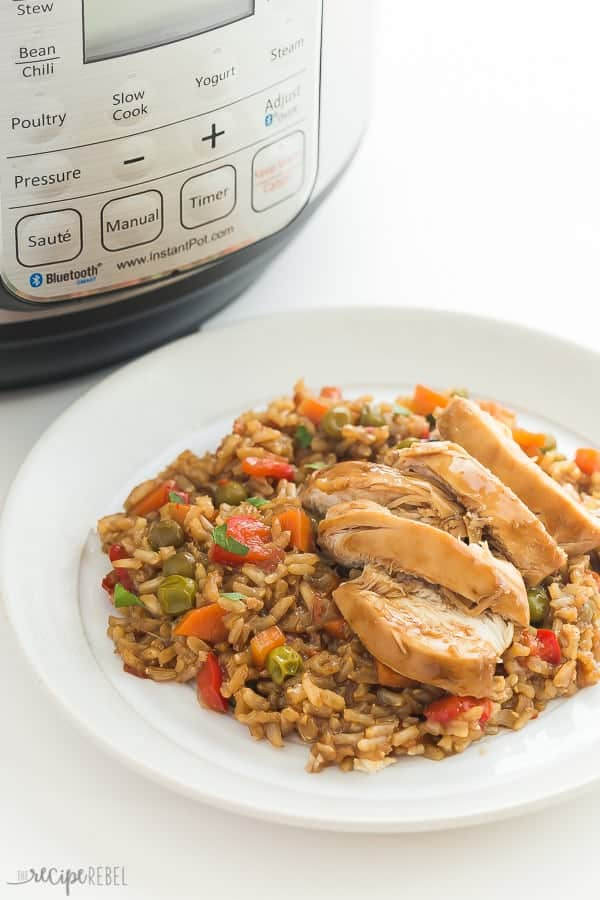 instant pot teriyaki chicken and rice on white plate in front of pressure cooker