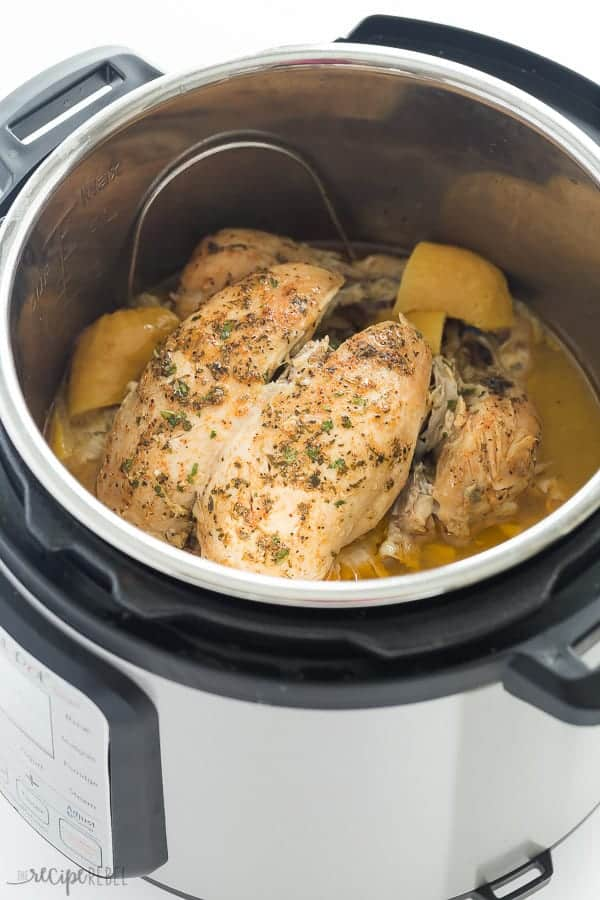 Instant Pot Whole Chicken in Pressure Cooker |This Instant Pot Whole Chicken recipe can be made with fresh or frozen chicken! It is moist, juicy and so much easier than roasting! Slathered in garlic butter and cooked to perfect in your pressure cooker in just 30 minutes.