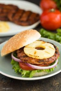 Hawaiian Chicken Burgers with Grilled Pineapple are an easy, healthy dinner recipe that's perfect for summer! Made with just a few simple ingredients and easy to make ahead or meal prep. Loaded with sweet and savoury flavours! Includes step by step recipe video.