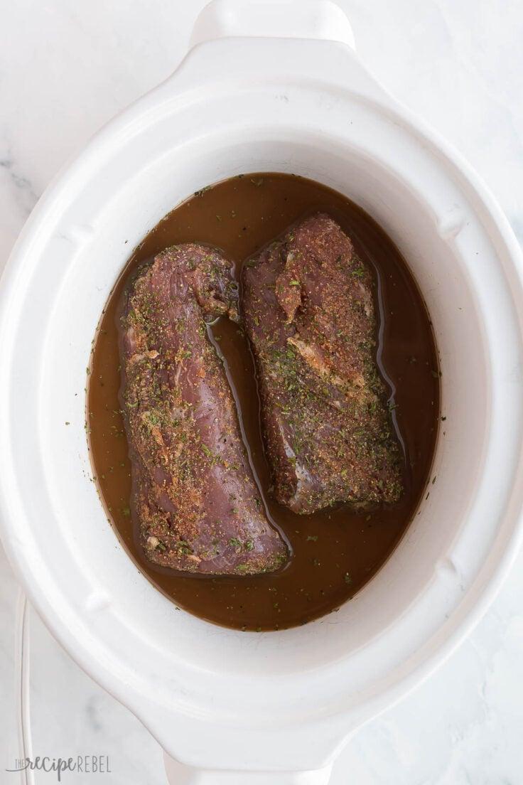 uncooked pork tenderloin in slow cooker with sauce