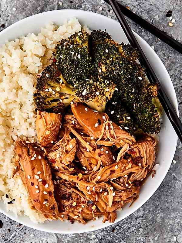 instant pot orange chicken overhead on white plate with rice and broccoli