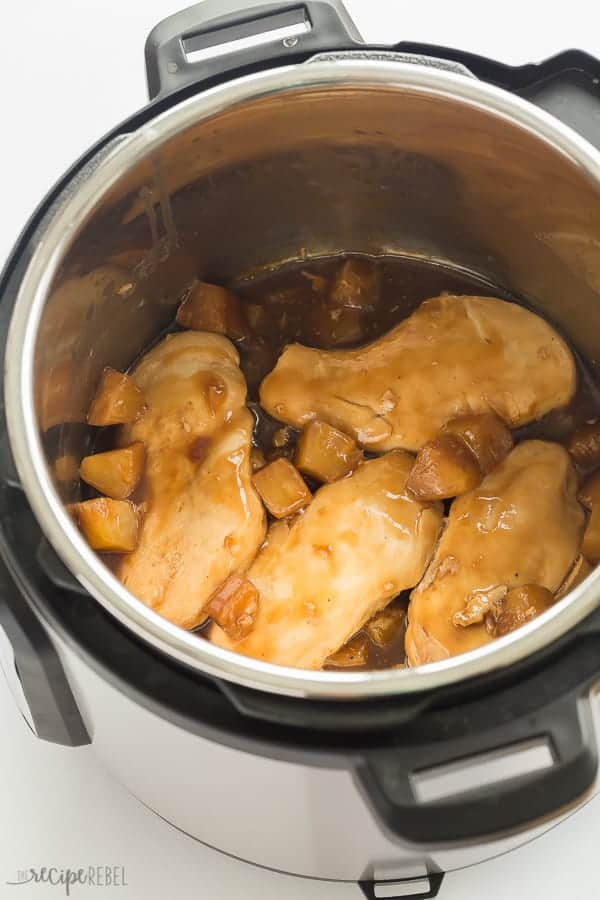 chicken breasts with pineapple sauce in instant pot on white background