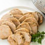 instant pot pork tenderloin on a white plate sliced